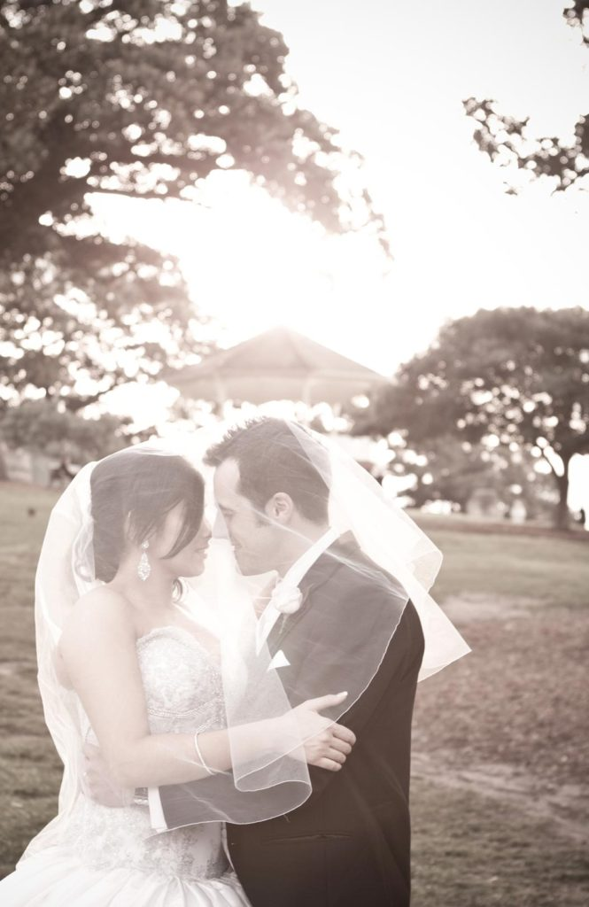 bride and groom embrace in sunshine