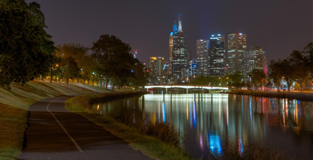 melbourne city behind the yarra river at night