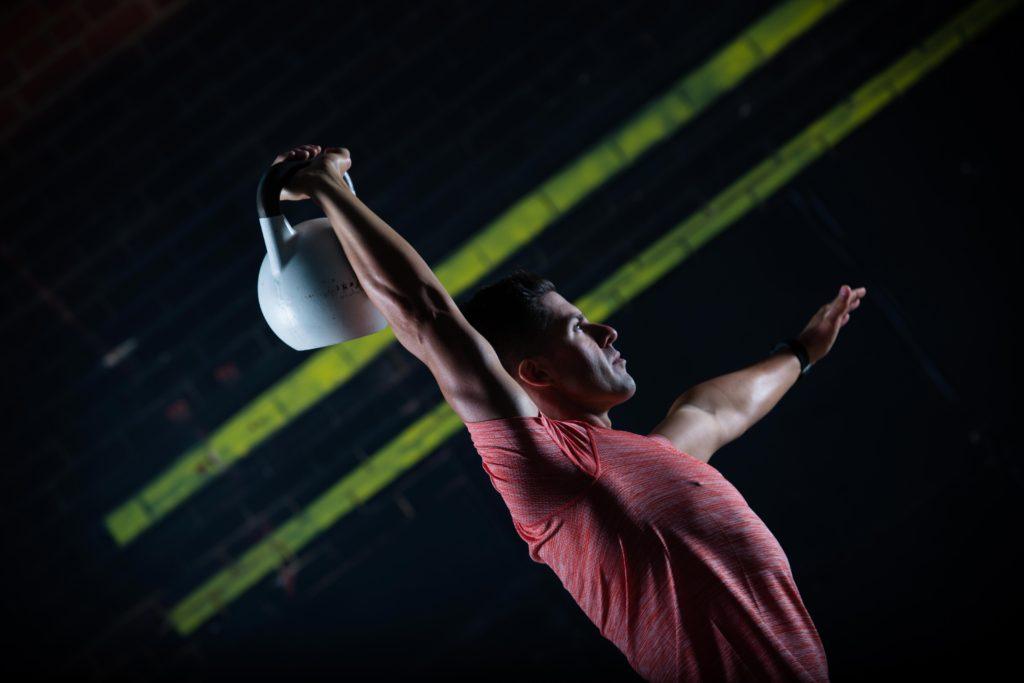 Fitness model overhead kettlebell press