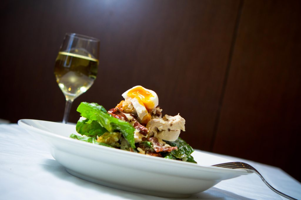 chicken ceasar salad and white wine dinner