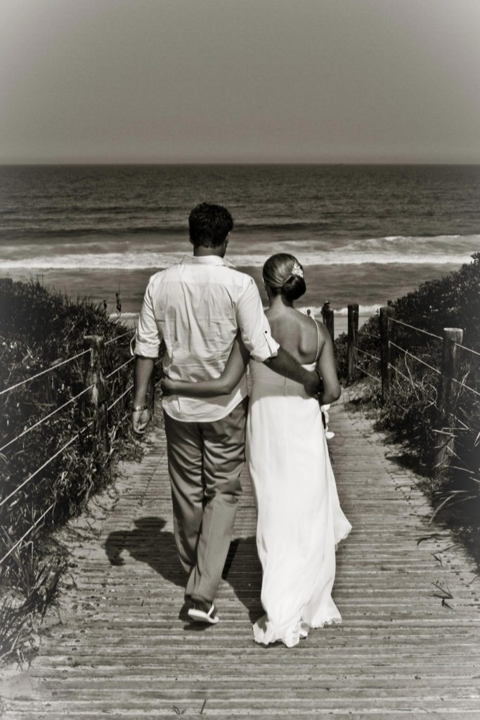 bride and brother walk