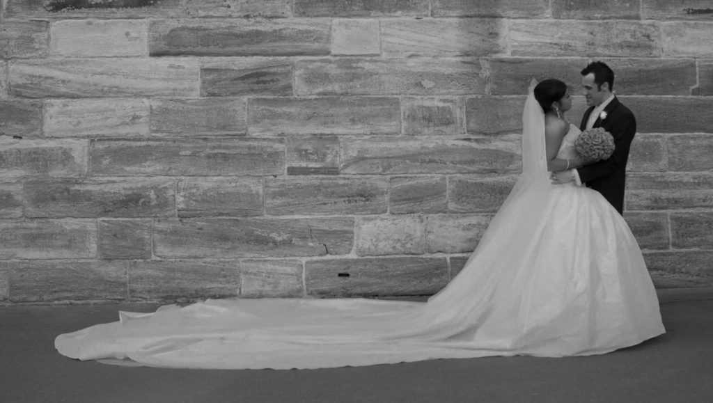 blakc and white bride and groom embrace